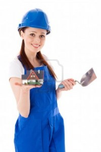 11816471-young-woman-in-coverall-with-trowel-and-model-of-house-on-a-white-background-female-construction-wor